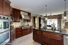 kitchen cabinets finishes i m really liking this look cherry cabinets uba 2989