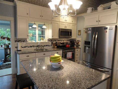 soft white kitchen cabinets 17 best ideas about caledonia granite on small 5591