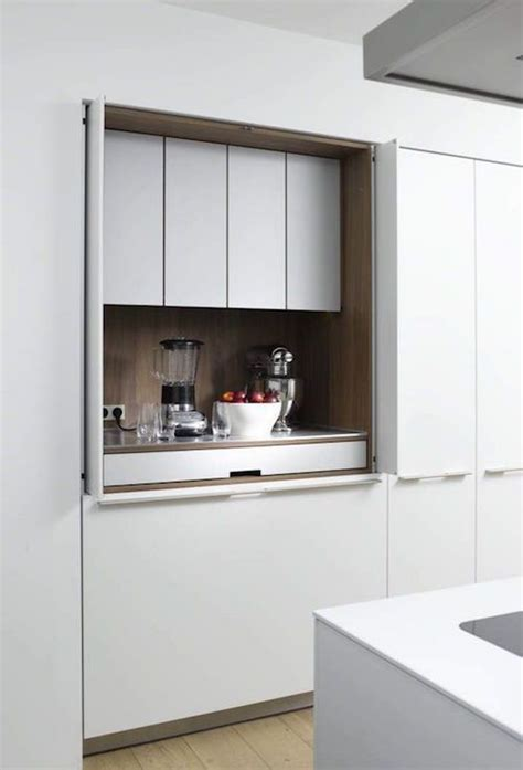 disappearing act  minimalist hidden kitchens hidden