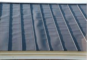 oil canning  metal roofing