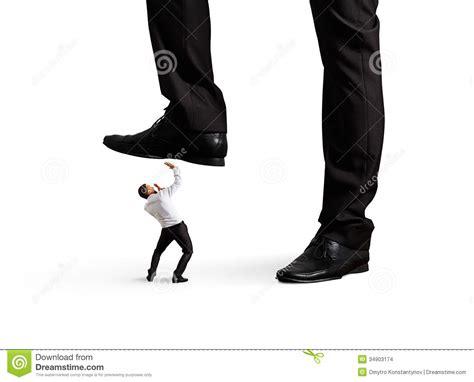 Man Under Leg His Boss Stock Images