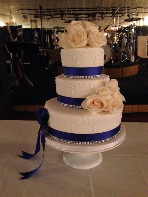 royal blue ribbon  white roses sweet  birthday cake