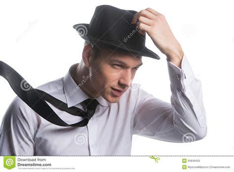 portrait  fashionable man holding  hat stock