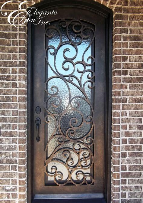 wrought iron door  eyebrow arch single doors