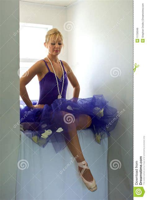 sitting ballerina   feet royalty  stock