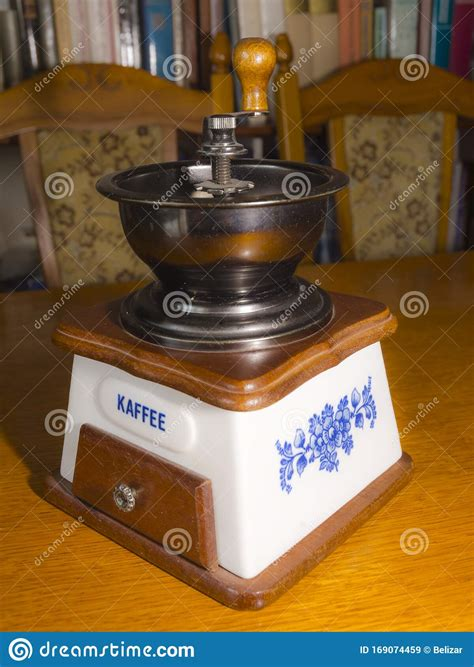 Grinding the beans is a big piece of the puzzle, and the importance of buying the right grinder for your tastes shouldn't be underestimated. Old Fashioned Coffee Grinder On A Table Stock Image - Image of traditional, life: 169074459