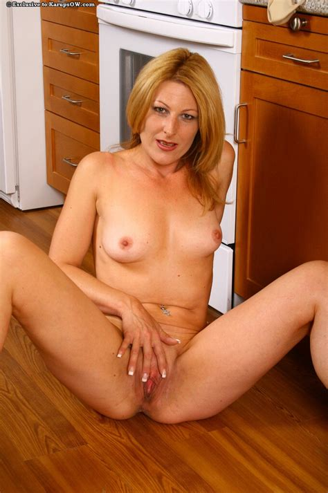 Hot Blonde Gets Naked And Horny In The Kitchen