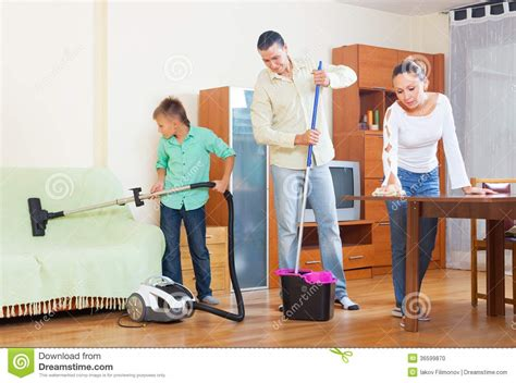 Clean The Living Room In by Family Cleaning In Living Room Stock Photo Image Of