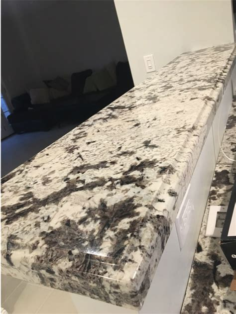 frameless espresso raised panel kitchen cabinets  ogee square edge granite countertop