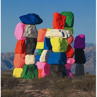ugo rondinone erects seven magic mountains in the nevada