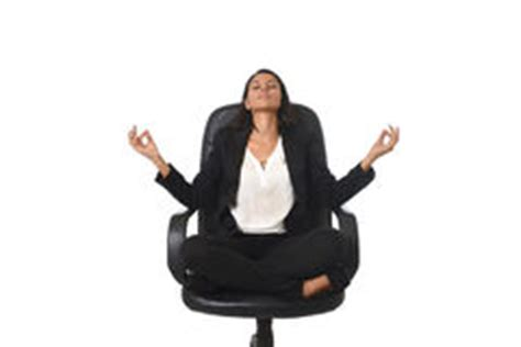 office sitting in calm lotus pose and relaxing