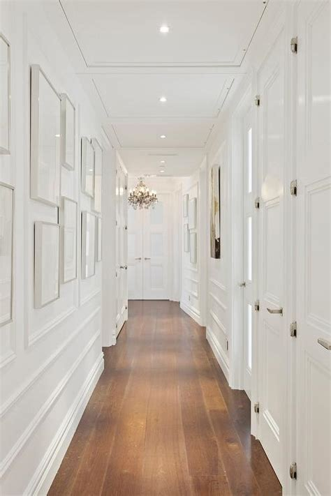 white hallway  gray picture frames transitional