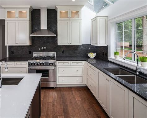 kitchen with white cabinets and black countertops white hanging cabinet finish patterned black granite