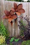 Creative Rusted Metal Garden Decorations You Need To See rusty metal flowers garden art
