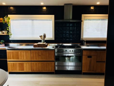 black tiles with wood kitchen stainless steel benchtop