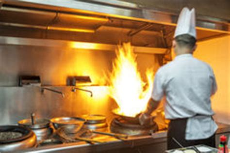 extraction cuisine restaurant chef in restaurant kitchen at stove with pan royalty free