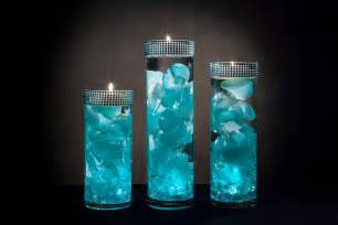 inexpensive wedding favors teal floral centerpieces with led lights and floating candles