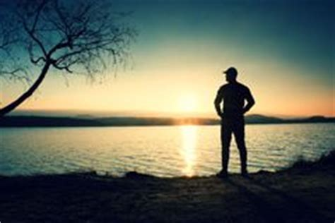silhouette young man stand beach sunset shadow active man