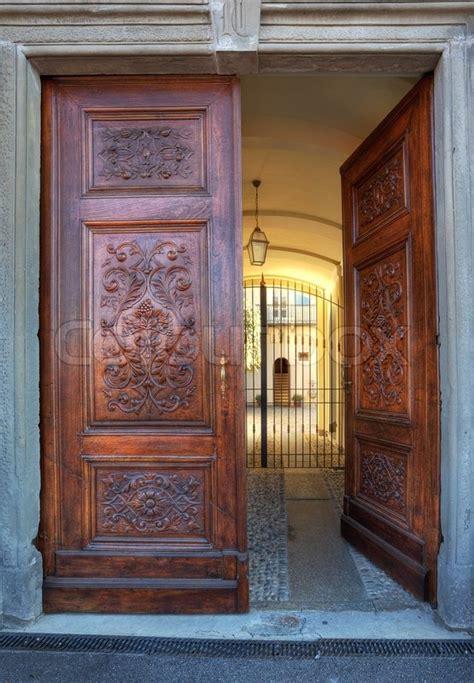 Vertical Oriented Image Of Beautiful Ornate Wooden Door At