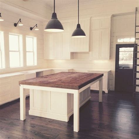 kitchen island and table lighting i love the white with the dark island flooring and door