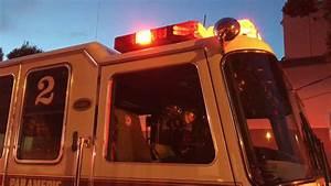 Back View Of Ambulance Idling Flashing Red Emergency ...