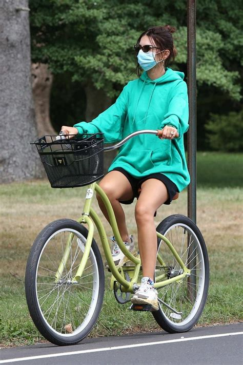 Emily Ratajkowski wears a green hoodie and shorts while ...