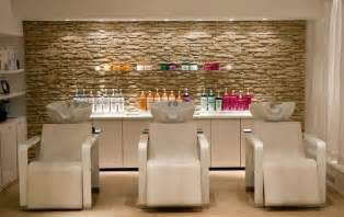 peach chairs with decorative stone wall for small hair