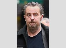Matthew Perry steps out in London looking tired and