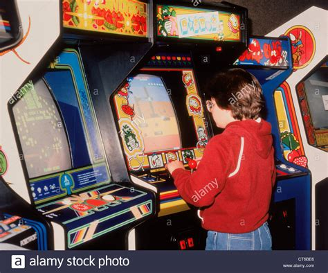 Boy Playing Vintage Video Arcade Games Stock Photo