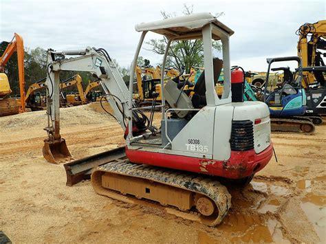 takeuchi tb mini excavator vinsn   stick  bucket aux hyd blade rubber
