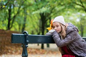 Girl Sitting Alone On The Bench On A Fall Day Stock Photo ...