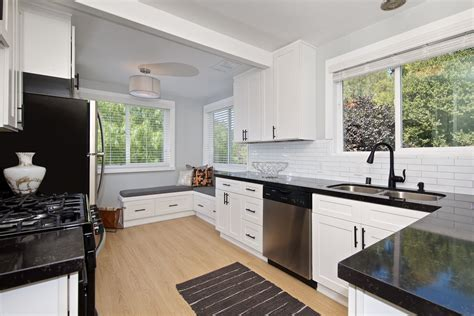 They can be transformed into any style with a change in hardware, kitchen backsplash, or lighting. New white shaker cabinet, black countertops, matte black ...