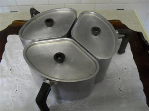 kitchenalia  vintage triangular aluminum hart cooking pots  sold