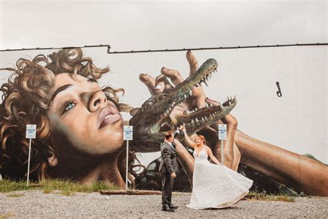 Tampa Bay Bride and Groom in front of St Pete Wall Mural