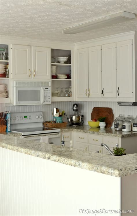 painting veneer kitchen cabinets white how to re paint your yucky white cabinets 7369