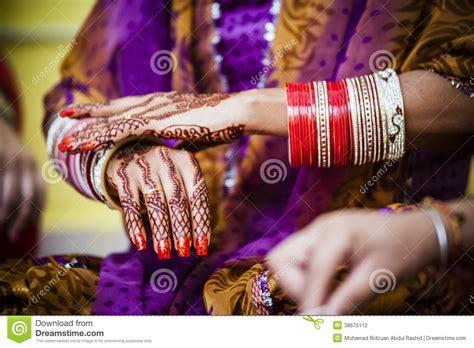 bride wearing bangle bracelet stock photography image
