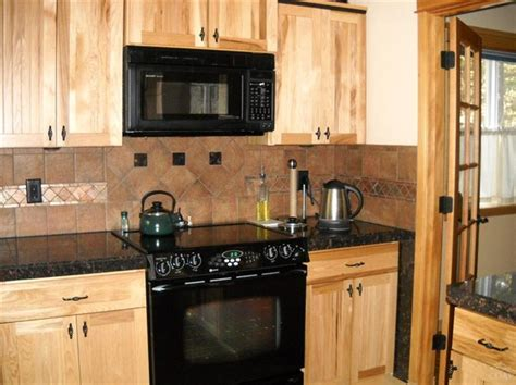 marble countertops with hickory cabinets counters