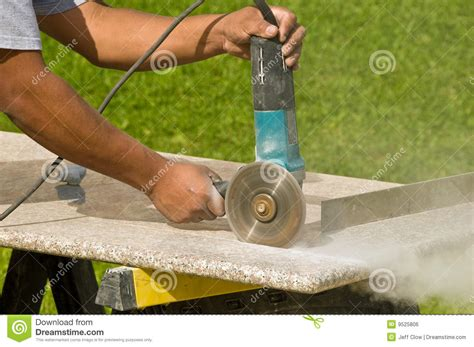 cutting granite countertops royalty free stock image
