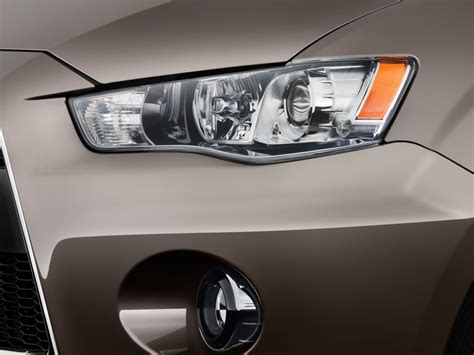 how to adjust headlight 2011 mitsubishi outlander sport