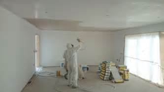 spray painting interior house walls and ceiling