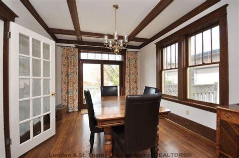 dining room  wood trim  ceiling beams natural
