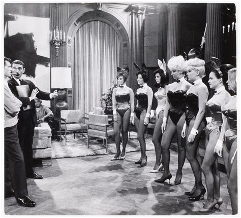 [Playboy publisher Hugh Hefner (left, with pipe ...