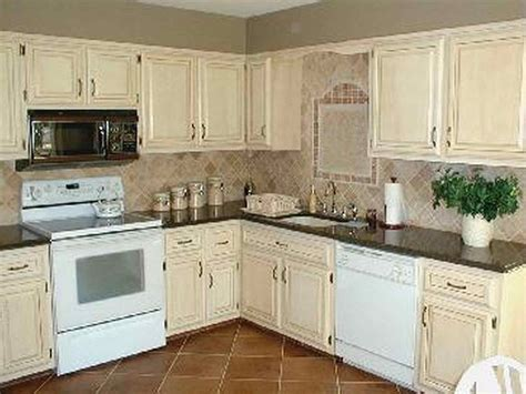 how to paint old kitchen cabinets how to paint your kitchen cabinets antique white