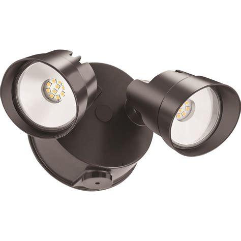 dusk to dawn led flood light lithonia lighting adjustable twin head bronze 120 watt
