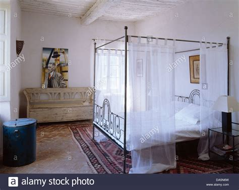 Metal Four Poster Bed With White Voile Drapes In White
