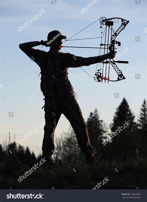 modern bow hunter silhouette   woods stock photo