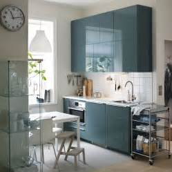 Armoire Metallique Bleue Ikea by A Small Modern Kitchen With White Walls And High Gloss
