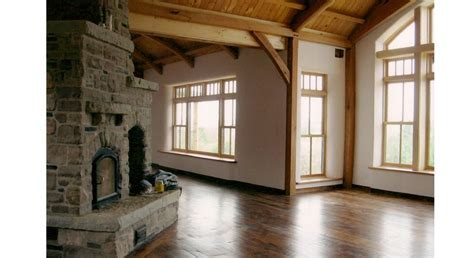 Timber Frame House with Straw Bale Walls, Clay Floors