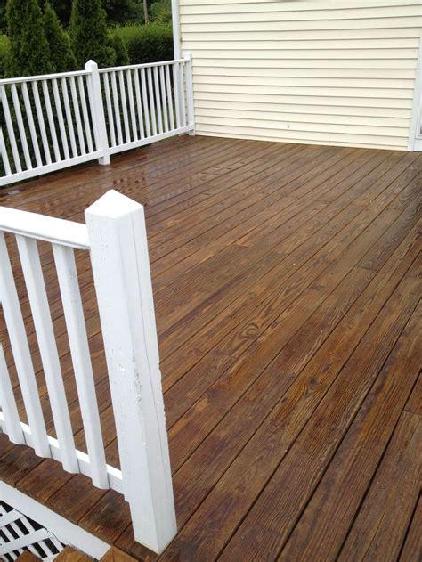 pressure treated wood decking  white painted trim