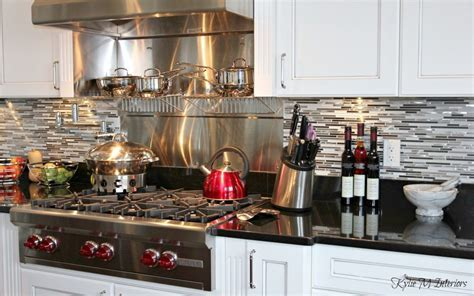 Beautiful chefs kitchen with white glazed cabinets, black